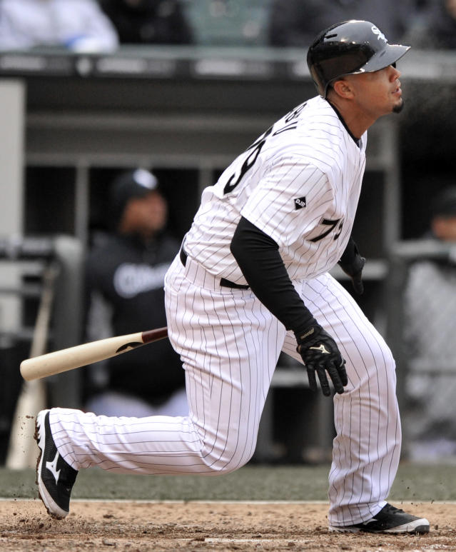 Chicago White Sox's Jose Abreu watches his three-run triple during the sixth inning of a baseball game against the Minnesota Twins in Chicago, Thursday, April 3, 2014. (AP Photo/Paul Beaty)