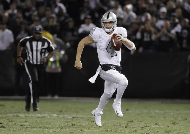 Oakland Raiders quarterback Derek Carr (4) scrambles against the Kansas City Chiefs during the second half of an NFL football game in Oakland, Calif., Thursday, Oct. 19, 2017. (AP Photo/Marcio Jose Sanchez)