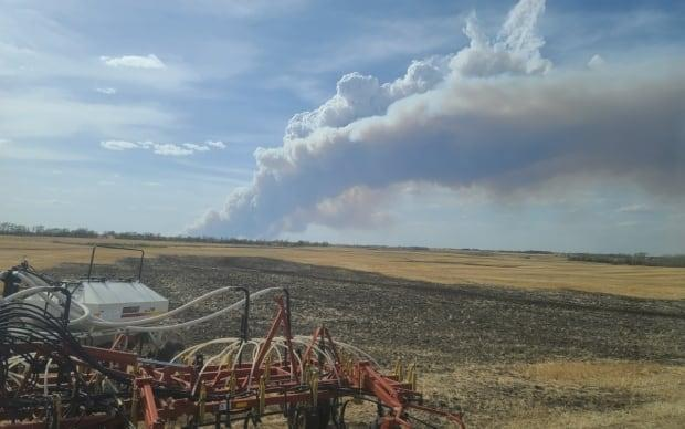 The fire could be seen from nearby farms. The police are asking people to avoid the area.