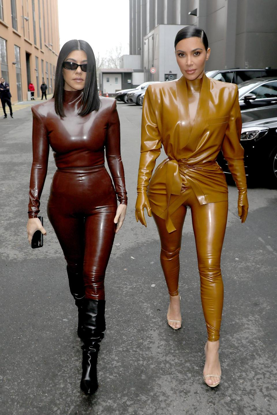 """<p>While 2020 might not have included many red carpets, that didn't stop the family from continuing to serve up looks, like these head-to-toe latex outfits. <strong>KUWTK</strong> viewers got a hilarious look at how hard it was for <a href=""""https://www.popsugar.com/fashion/kim-kardashian-latex-balmain-outfit-video-clip-47332225"""" class=""""link rapid-noclick-resp"""" rel=""""nofollow noopener"""" target=""""_blank"""" data-ylk=""""slk:Kim to get into this Balmain outfit before the show"""">Kim to get into this Balmain outfit before the show</a>.</p>"""