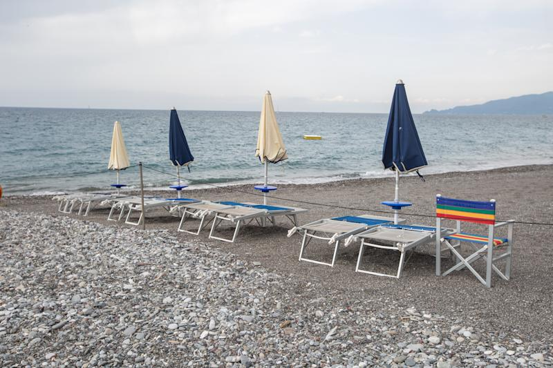 Empty sunbeds and closed sun umbrellas, in Lavagna, Italy, on August 12, 2019. As the weather was cloudy and rainy in Northern Italian region Ligury in the town of Lavagna (GE) at the beach there were very few people. (Photo by Alexander Pohl/NurPhoto via Getty Images)