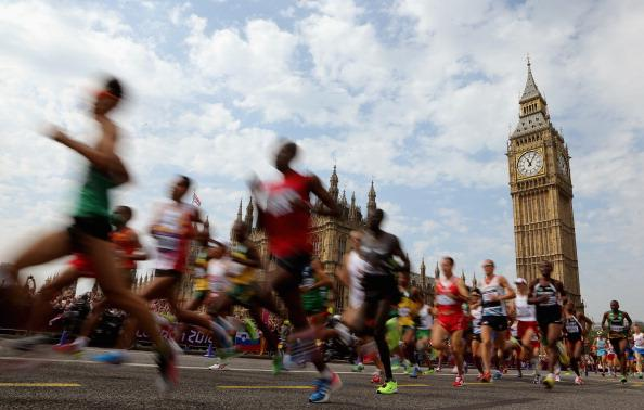 Athletes pass the Palace of Westminster as they compete in the Men's Marathon on Day 16 of the London 2012 Olympic Games on the streets of London on August 12, 2012 in London, England. (Photo by Ezra Shaw/Getty Images)