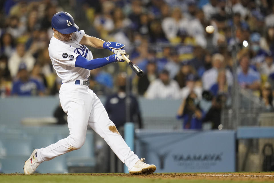 Los Angeles Dodgers' Trea Turner hits a grand slam home run during the fifth inning of a baseball game against the Milwaukee Brewers Friday, Sept. 1, 2021, in Los Angeles. Austin Barnes, Albert Pujols, and Mookie Betts also scored. (AP Photo/Ashley Landis)