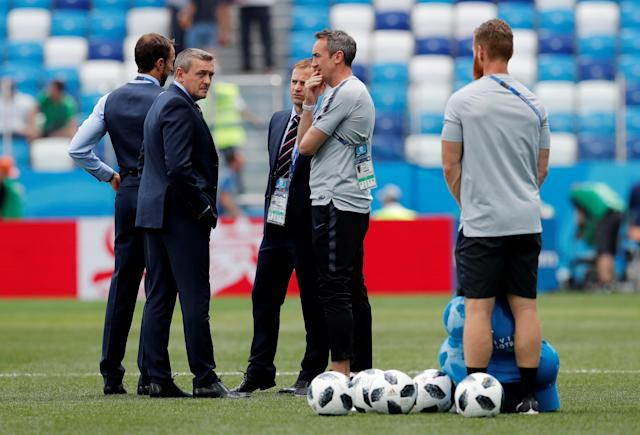 Soccer Football - World Cup - Group G - England vs Panama - Nizhny Novgorod Stadium, Nizhny Novgorod, Russia - June 24, 2018 England Under 21 manager Aidy Boothroyd, manager Gareth Southgate and FA technical director Dan Ashworth inside the stadium before the match REUTERS/Carlos Barria