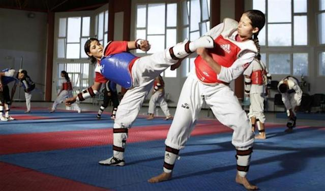 Tunisian Taekwondo athlete Khaoula Ben Hamza (in blue) trains during preparations for the 2012 London Olympic Games in Tunis May 25, 2012.