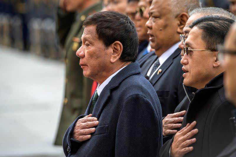 FILE PHOTO: Philippine President Rodrigo Duterte attends a wreath laying ceremony at the Tomb of the Unknown Soldier in Moscow