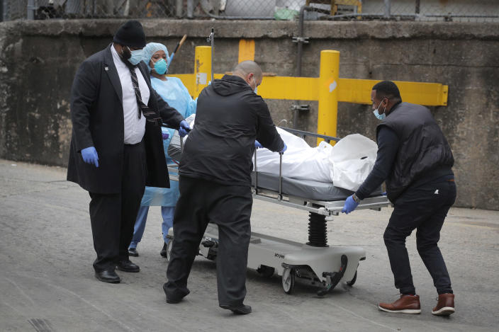 Workers wheel a deceased person outside of Brooklyn Hospital Center during the coronavirus disease (COVID-19) outbreak in the Brooklyn borough of New York (Brendan McDermid / Reuters)