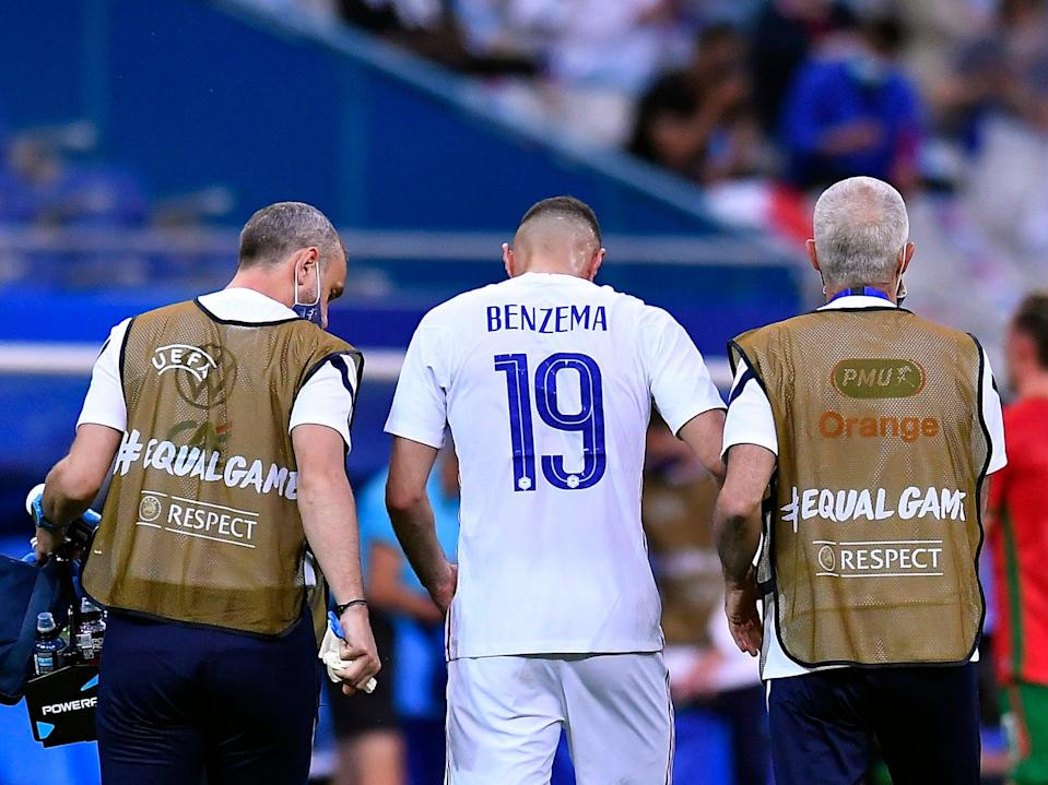 <p>Karim Benzema of France exits after an injury</p> (Getty)