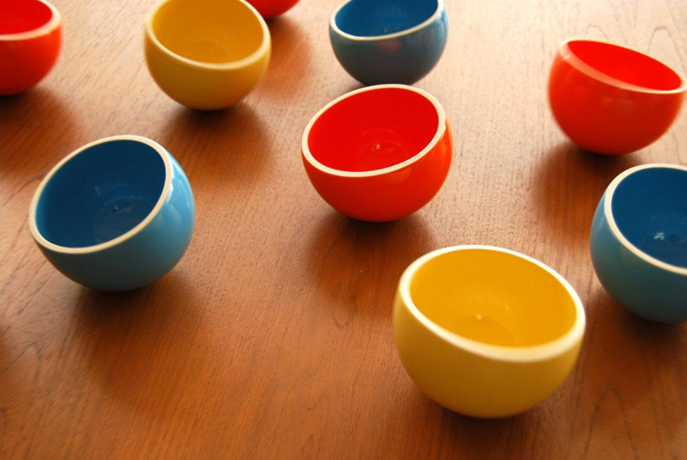 """<a href=""""http://www.kickstarter.com/projects/speechless/wobble-bowls-by-speechless-studios?ref=category"""">Wobble Bowls</a>  are round-bottomed bowls that rock and spin, but won't tip over. The  bowls are offered in bright orange, yellow or blue. The bowls' low  center of gravity makes it possible for them to remain stable and right  themselves when tipped over. The bowls are well-suited to be used as  serving bowls, snack bowls or for just throwing coins into at the end of  the day. In one month, Wobble Bowls raised $42,384 from nearly 600  backers."""