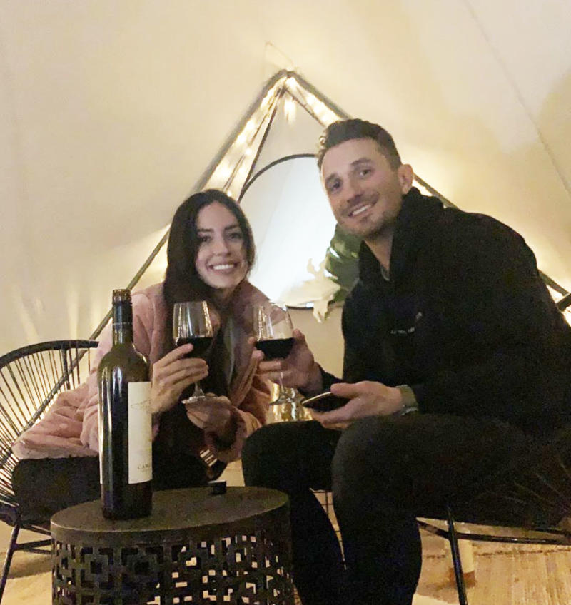 The Project's Tommy Little and his new girlfriend Natalie Kyriacou drinking wine in a tent in Gippsland, Victoria.