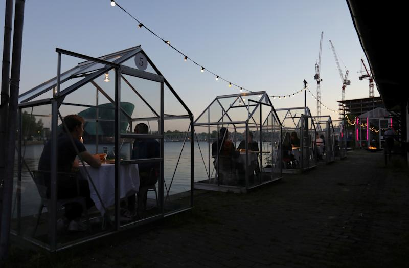 ETEN restaurant invited guests to try out the small glass cabins (Picture: Reuters)