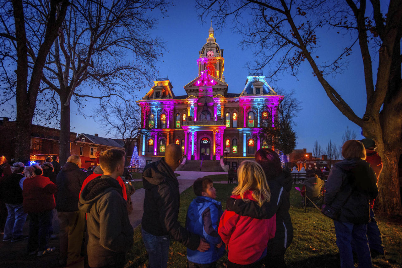"This Nov. 14, 2015 image provided by the Cambridge/Guernsey County Visitors & Convention Bureau shows the Guernsey County Courthouse during the light and music show that plays nightly during the city's annual holiday festivities. The city also hosts a Dickens Victorian Village with characters and scenes inspired by the Victorian era and ""A Christmas Carol."" (Rick Lee/Cambridge/Guernsey County Visitors & Convention Bureau via AP)"