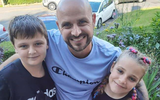 Jason Bennett with his son, John, and daughter, Lacey. The children were among four people found dead at a house in Killamarsh, Derbyshire, on Sunday