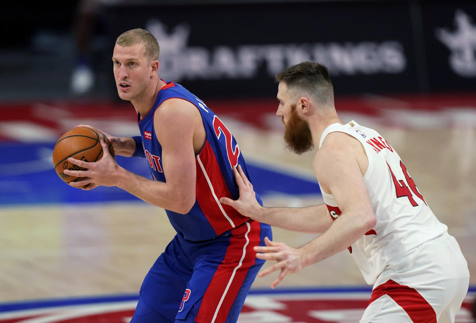 FILE - In this March 17, 2021, file photo, Detroit Pistons center Mason Plumlee is defended by Toronto Raptors center Aron Baynes during an NBA basketball game in Detroit. The Charlotte Hornets didn't wait until the 11th pick in the NBA draft to address their biggest need, acquiring Plumlee and the No. 37 pick from the Detroit Pistons on Thursday night, July 29, a person familiar with the situation told The Associated Press. (AP Photo/Carlos Osorio, File)