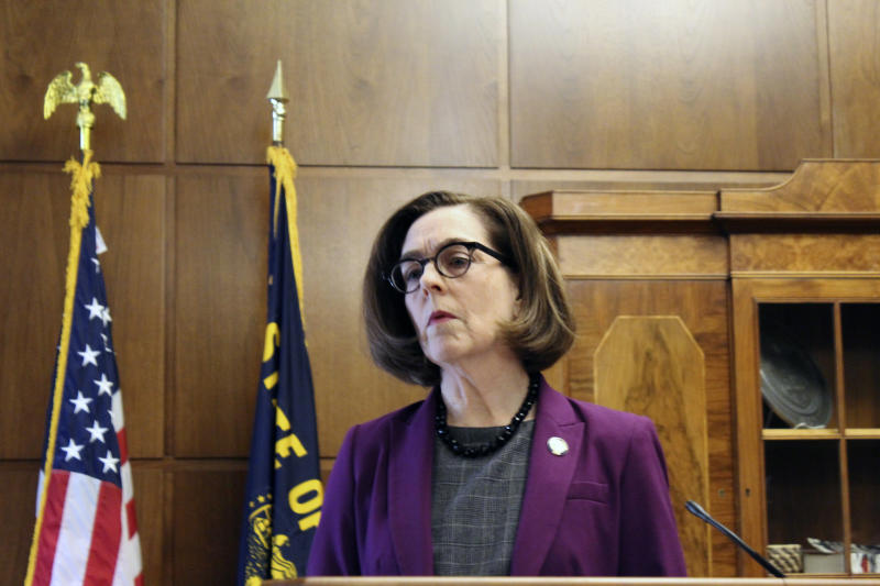 Gov. Kate Brown of Oregon denounces a walkout by Republicans in the state Senate that prevented a quorum on Monday, Feb. 24, 2020 in Salem, Ore. Republican lawmakers are trying to doom a contentious climate change bill. Brown said the Republicans are not against the climate policy but are against the Democratic process. (AP Photo/Andrew Selsky)