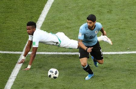 Uruguay's Luis Suarez in action with Saudi Arabia's Ali Al-Bulaihi. REUTERS/Marcos Brindicci