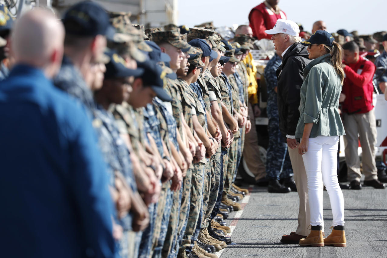<p>President Donald Trump and first lady Melania Trump greet troops as they depart the USS Kearsarge off the coast of San Juan, Puerto Rico, Oct. 3, 2017. (Photo: Jonathan Ernst/Reuters) </p>
