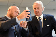 South Carolina Gov. Henry McMaster, right, listens as Foster Jordan of Charles River Labs, left, talks about the properties of horseshoe crab blood, which is a vital component in the contamination testing of injectable medicines - including the coronavirus vaccines - at Charles River Labs on Friday, Aug. 6, 2021, in Charleston, S.C. McMaster says the South Carolina company that bleeds horseshoe crabs for a component crucial to contamination testing of injectable medications is vital to development of a domestic medical supply chain. (AP Photo/Meg Kinnard)