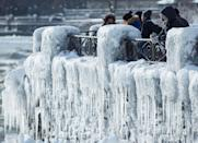 <p>Visitors take pictures near the brink of the ice-covered Horseshoe Falls in Niagara Falls, Ontario, Canada, January 3, 2018. REUTERS/Aaron Lynett </p>