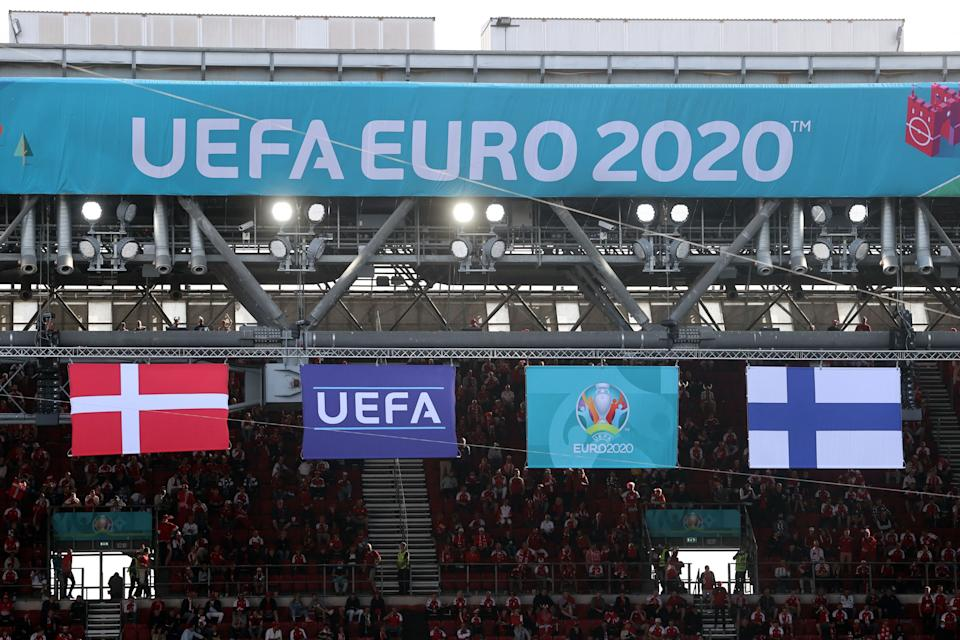 Denmark's and Finland's (R) flags flutter during the UEFA EURO 2020 Group B football match between Denmark and Finland at the Parken Stadium in Copenhagen on June 12, 2021. (Photo by WOLFGANG RATTAY / POOL / AFP) (Photo by WOLFGANG RATTAY/POOL/AFP via Getty Images) (Photo: WOLFGANG RATTAY via Getty Images)