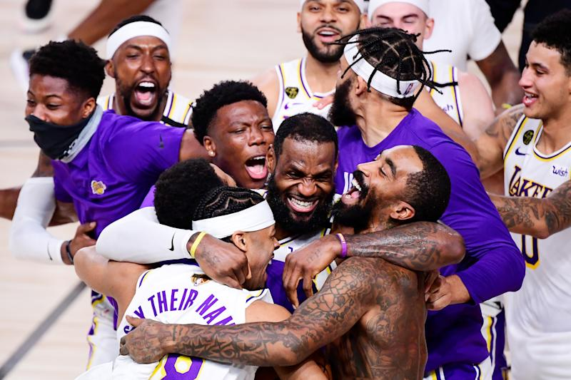 LAKE BUENA VISTA, FLORIDA - OCTOBER 11: LeBron James #23 of the Los Angeles Lakers celebrates with Quinn Cook #28 of the Los Angeles Lakers and teammates after winning the 2020 NBA Championship in Game Six of the 2020 NBA Finals at AdventHealth Arena at the ESPN Wide World Of Sports Complex on October 11, 2020 in Lake Buena Vista, Florida. NOTE TO USER: User expressly acknowledges and agrees that, by downloading and or using this photograph, User is consenting to the terms and conditions of the Getty Images License Agreement. (Photo by Douglas P. DeFelice/Getty Images)