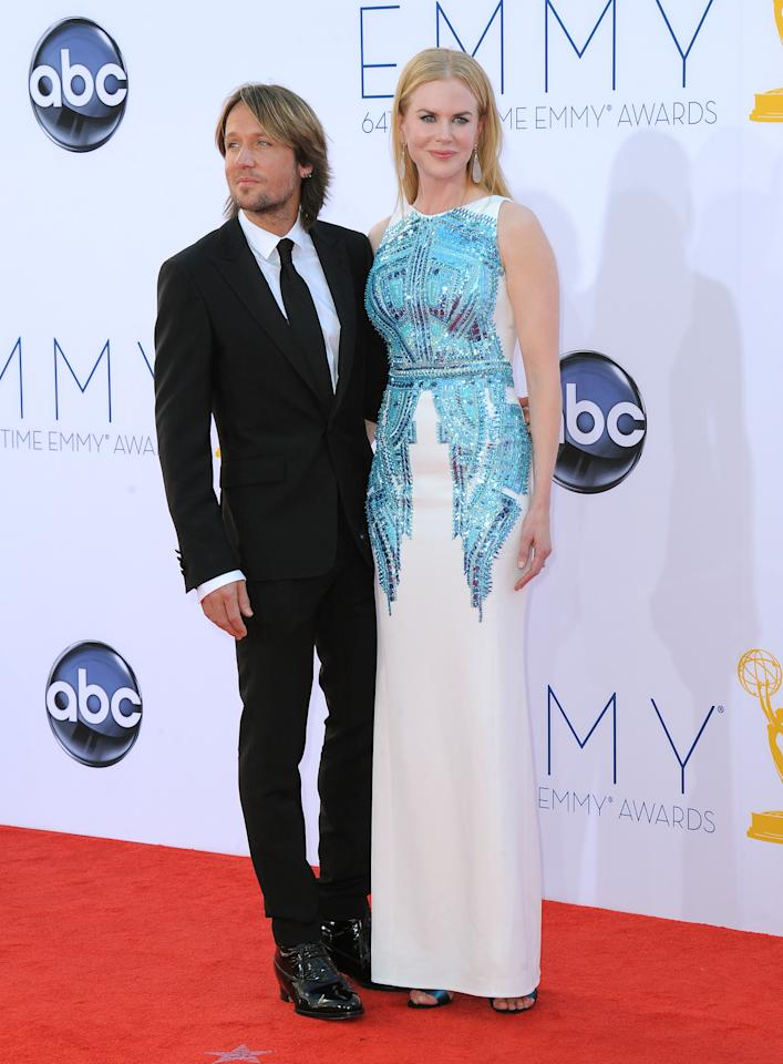 Keith Urban, left and Nicole Kidman arrive at the 64th Primetime Emmy Awards at the Nokia Theatre in Los Angeles on September 23, 2012.