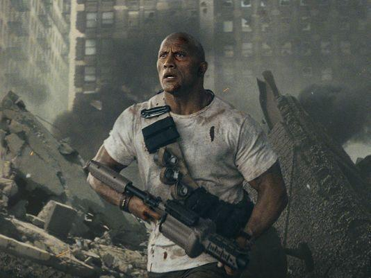 The Rock fights giant monster animals in the first trailer for Rampage. Source: Warner Bros