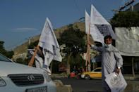 More Taliban flags on sale in Kabul on August 22, 2021, where streets are quiet since the militants' takeover -- except for around the airport as tens of thousands continue to try to flee