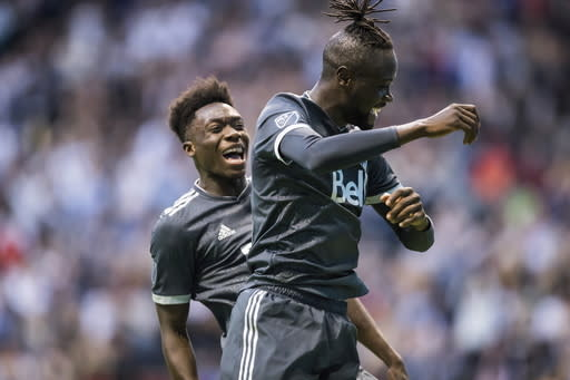 Vancouver Whitecaps' Kei Kamara, front, and Alphonso Davies celebrate Kamara's second goal against the Chicago Fire, during the second half of a Major League Soccer match Saturday, July 7, 2018, in Vancouver, British Columbia. (Darryl Dyck/The Canadian Press via AP)