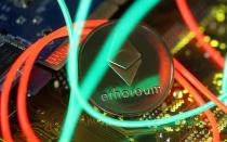 FILE PHOTO: Representation of the Ethereum virtual currency standing on the PC motherboard are seen in this illustration picture