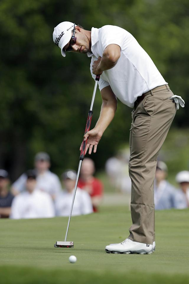Adam Scott putts on the ninth hole during the third round of the PGA Colonial golf tournament in Fort Worth, Texas, Saturday, May 24, 2014. (AP Photo/LM Otero)