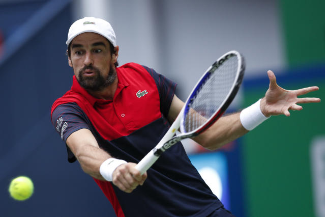 Jeremy Chardy of France hits a return shot against Alexander Zverev of Germany during the men's singles match at the Shanghai Masters tennis tournament at Qizhong Forest Sports City Tennis Center in Shanghai, China, Wednesday, Oct. 9, 2019. (AP Photo/Andy Wong)