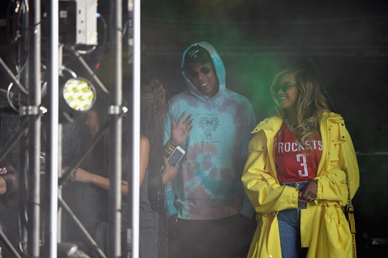 Jay-Z and Beyoncé watch a performance from the stage on Sunday. (Kevin Mazur via Getty Images)