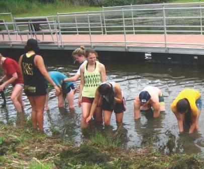 May 18, 2012. USC Environmental Studies students removing aquatic invasive algae from Masso Reservoir on Guam. Photo by author.