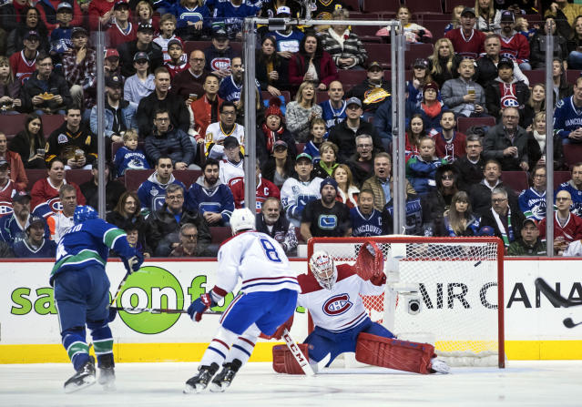 Montreal Canadiens goalie Carey Price, right, stops Vancouver Canucks' Michael Del Zotto, left, as Montreal's Jordie Benn (8) watches during the first period of an NHL hockey game in Vancouver, British Columbia, Saturday, Nov. 17, 2018. (Darryl Dyck/The Canadian Press via AP)