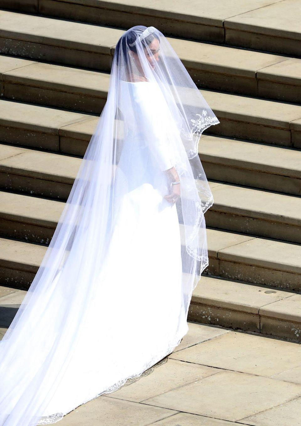 <p>Meghan's simple-but-elegant wedding gown was offset by a spectacular veil, embellished with delicate embroidery along the edges. </p>