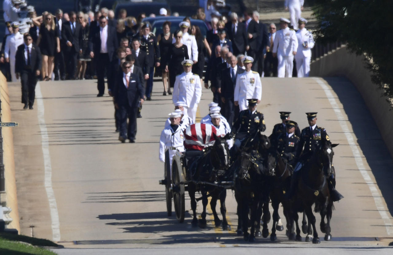 <p>Family members, including Cindy McCain, back center, follow a horse-drawn caisson carries the casket of Sen. John McCain, R-Ariz., as it proceeds to the United States Naval Academy cemetery in Annapolis, Md., Sunday, Sept. 2, 2018, for burial. (Photo: Susan Walsh/AP) </p>