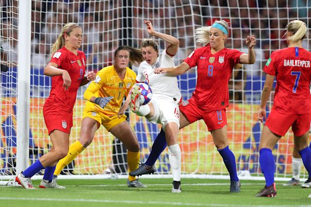 Ellen White of England is challenged by Julie Ertz of the USA and Lindsey Horan of the USA during the 2019 FIFA Women's World Cup France Semi Final match between England and USA at Stade de Lyon on July 02, 2019 in Lyon, France. (Photo by Catherine Ivill - FIFA/FIFA via Getty Images)