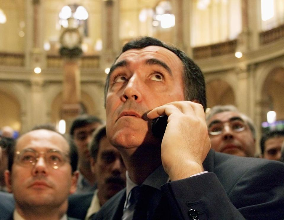 Inditex Vice president Jose Maria Castellano speaks on the phone as the Spanish clothes giant Inditex, better known by its clothing stores Zara, is introdueced 23 May 2001 on the Spanish stock exchange in Madrid.     AFP PHOTO     CHRISTOPHE SIMON (Photo by Christophe SIMON / AFP)        (Photo credit should read CHRISTOPHE SIMON/AFP via Getty Images)