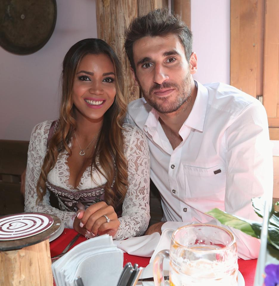 FC Bayern Munich's Javi Martinez and his partner Aline Brum pose during their visit at the Oktoberfest in Munich, Germany, September 23, 2017. REUTERS/Alexandra Beier/Pool
