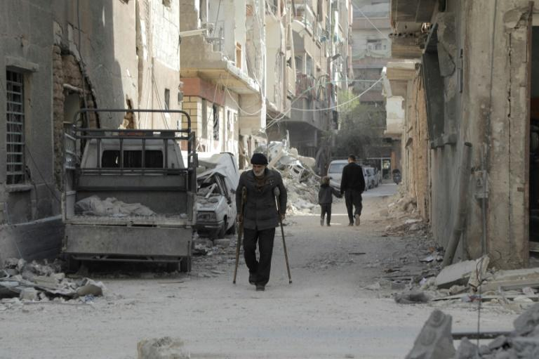 Syrian regime continue strikes on besieged Douma