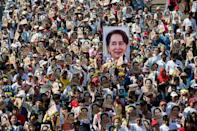Flag-waving supporters have joined rallies in support of Suu Kyi in several Myanmar cities