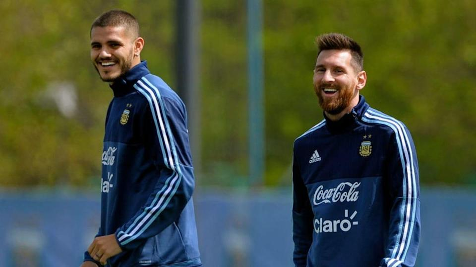 Mauro con Messi | AFP Contributor/Getty Images