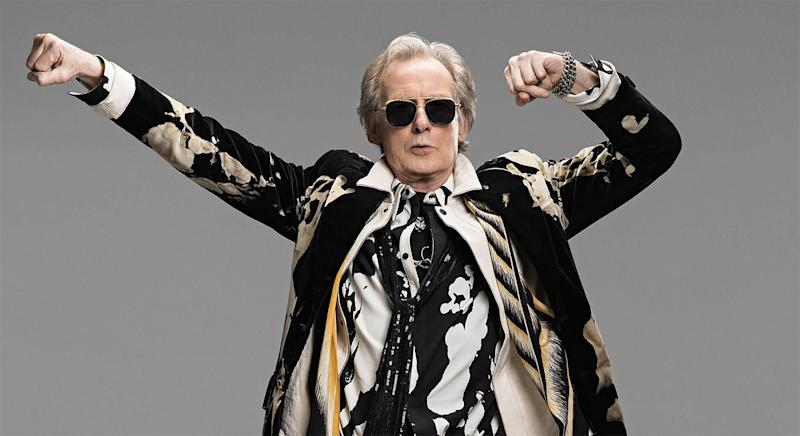 Bill Nighy as Billy Mack in a publicity still for Red Nose Day Actually (Comic Relief/EW)