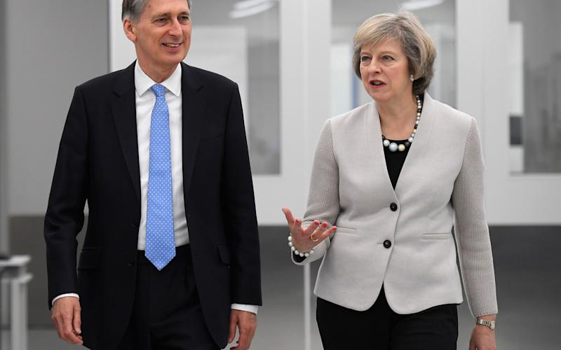 Prime Minister Theresa May reportedly told Chancellor Philip Hammond - Credit: PA/PA