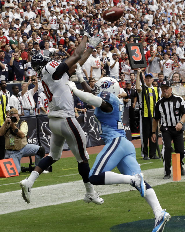 Houston Texans' DeAndre Hopkins (10) catches the winning touchdown over Tennessee Titans' Jason McCourty, right, during overtime of an NFL football game on Sunday, Sept. 15, 2013, in Houston. (AP Photo/David J. Phillip)