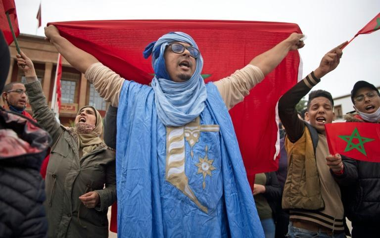 Moroccans celebrated in front of the parliament building in Rabat after the US adopted a new official map of Morocco that includes the disputed territory of Western Sahara