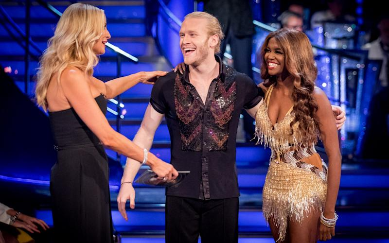Paralympic athlete Jonnie Peacock and partner Oti Mabuse chat to Tess Daly. - WARNING: Use of this copyright image is subject to the terms of use of BBC Pictures' Digital Picture