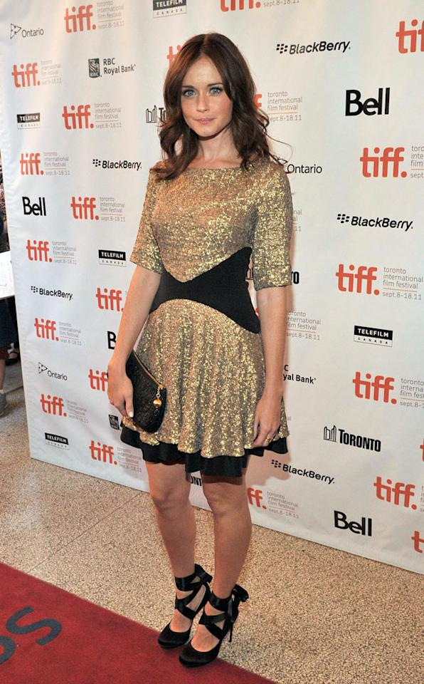 """Also glittering in gold ... former """"Gilmore Girls"""" actress Alexis Bledel, who worked the arrivals line at the """"Violet & Daisy"""" debut in a sexy Saloni Fall 2011 dress, ballet-inspired stilettos, and soft curls. Sonia Recchia/<a href=""""http://www.gettyimages.com/"""" target=""""new"""">GettyImages.com</a> - September 15, 2011"""