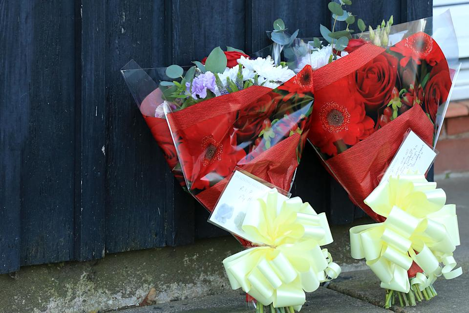 Handout photo of floral tributes near a property in Bosworth Road, Adwick, Doncaster, after two-year-old Keigan Ronnie O'Brien died in hospital after being found in cardiac arrest at the property on Wednesday (PA)